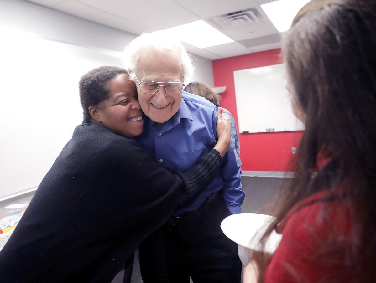 Bob receiving hug from student