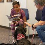 Odyssey Junior student reads book aloud