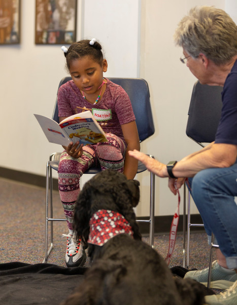 Odyssey Junior student reads book aloud