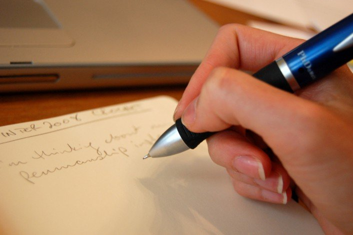 Closeup of person writing with pen