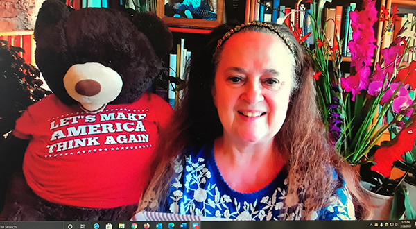 Emily with bear that says 'Let's make America think again'