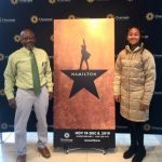 Bruce and Sidney pose with Hamilton sign