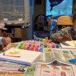 Layla and her sister, Naliyah painting
