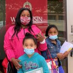 Odyssey student and her two daughters in masks