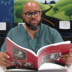 Edward, a current student enrolled in Afro Am 155, reads intently from his course textbook