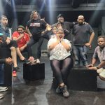 Odyssey theatre class poses on stage