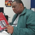 Devin, a student in Afro-American Studies 155 (spring 2021) reads a booklet